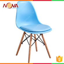 New design comfortable modern colorful pp material dining room used cheap wooden legs dinner chair with cushion