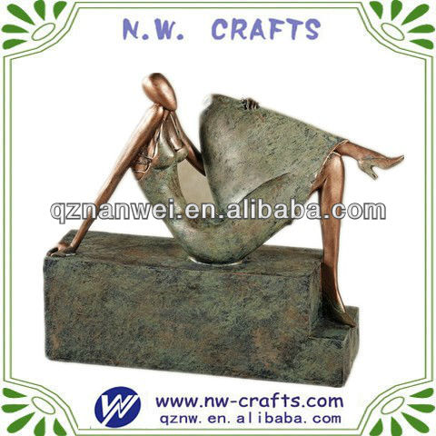 Abstract resin sculpture with elegant sitting lady