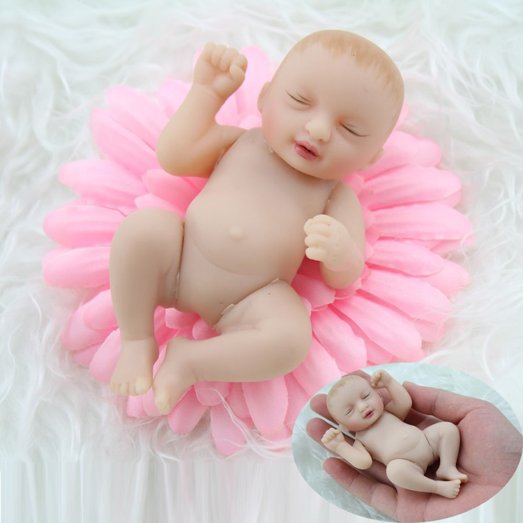 Newest design vinyl 4 inch baby dolls palm hand doll toy small vinyl reborn baby doll