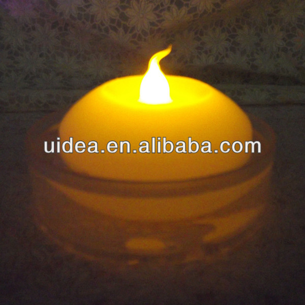 Amber flickering Flameless LED Floating Wax Candle Light