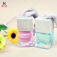 air freshener empty wooden cap hanging car perfume bottles