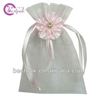 elegant small organza drawstring pouch / bag with satin flower decoration