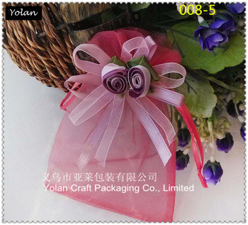 purplish red organza bag with big flower use for wedding candy