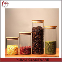 cylinder shaped glass storage jar with bamboo lid