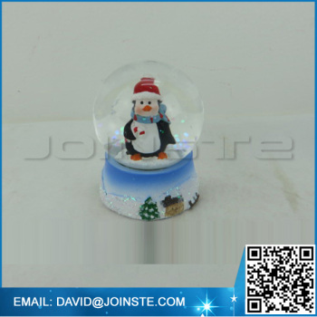 Christmas penguin snow globe