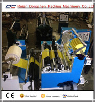 Paper or plastic film slitting and rewinding machine
