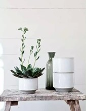 White ceramic flower pot with egg shape