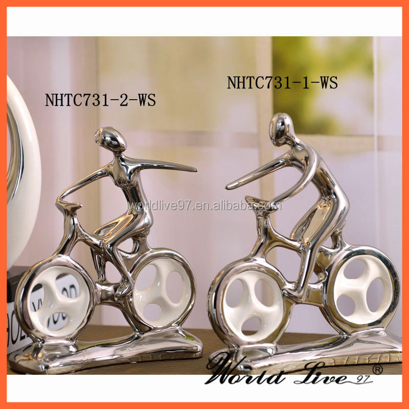 NHTC731-1-WS White and Silver Ceramic Young Boy on Bike Office Decoration