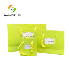Gift package musical Green Retail shopping bag with ribbon