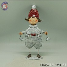 interior xmas decorations items with metal girl holding stars