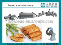 Extruded snack production machine/processing line