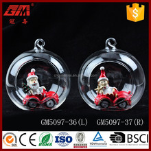 Factory direct sell resin santa claus christmas decoration with clear blown glass ball