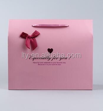OEM service pink paper gift bag with hot stamping