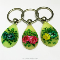 Wholesale real flower colorful keychain glow drop shape charming acrylic keychain