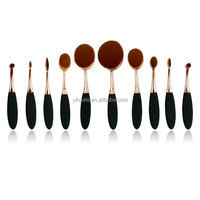 new oval 10pcs toothbrush style foundation brushes set with rose and black handle