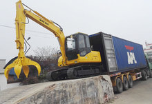 small excavator with grapper for steel loading