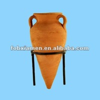 antique terracotta amphora on the stand