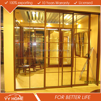Aluminium sliding glass door with grills design comply with Australian standard .