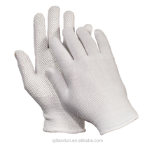 Seamless polyester gloves with PVC dots in palm. Elastic cuff gloves