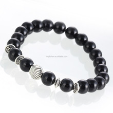 Tibetan silver alloy shell and elastic line black buddha bead bracelet wholesale