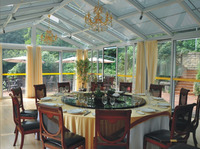 sun room with folding glass door