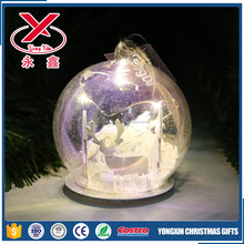 Clear Christmas glass led lighted ball with wood chip in it