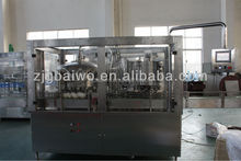 Beverage can filling and seaming machine