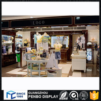 Luxury display female sitting mannequin / display cabinet slat board / shirt display racks for Clothes Shop