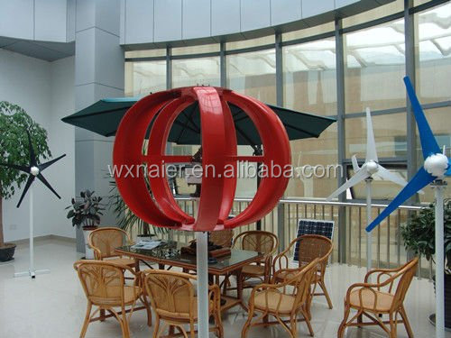 small decorative vertical axis wind turbine in garden