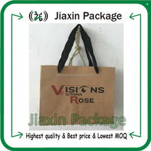 Customized brown kraft paper shopping bag with ribbon handle and logo
