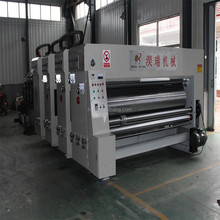 Chain feeder corrugated paperboard water transfer flexo printer slotter and die cutter machine
