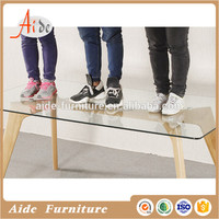 Elegant appearance modern tempered glass top long solid wood dining table design
