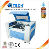 low cost XJ6090 gold laser cutting machine special for plastic cutting and engraving