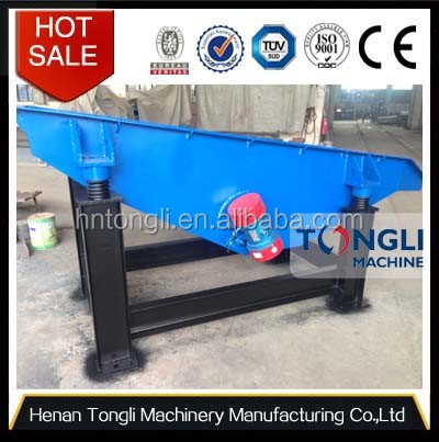 Vibrating feeder for metal shredder