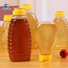 /product-detail/sale-360ml-500g-oval-shaped-plastic-smooth-glaze-honey-squeezing-bottle-with-screw-cap-60820824645.html