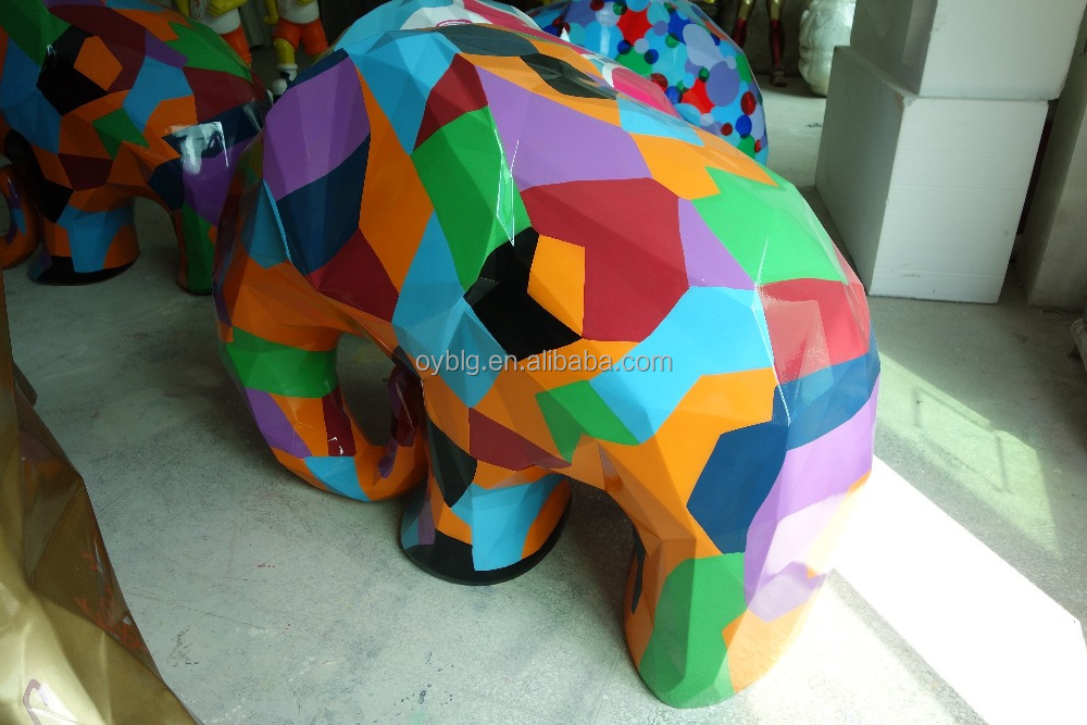 Life size painted colorful elephant cartoon sculpture
