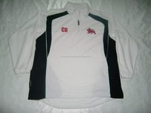 Mens polar fleece white with black panels embroidered and heatseal logos with 1/4 zip on front and elastic cuffs jacket