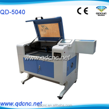 lasers engraver 60w/china cheap laser engraver cutter QD-5040 co2 laser engraver cutting machine with honey comb working table