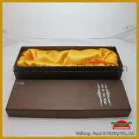 wine packing with golded silk