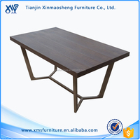 New Design High Grad Brown MDF Wood Top Painting Leg Dining Table with 4 Chairs