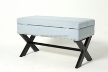Sky blue indoor storage fabric bench with black wood legs