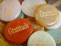 engraved semi-precious stone with word gratitude