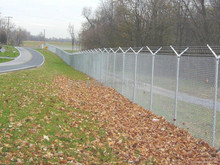 chain link fence top barbed wire
