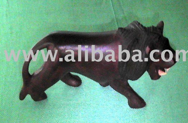 Hand carved wooden lion figurine