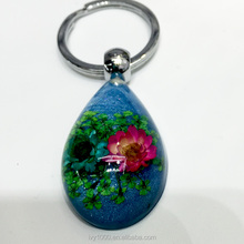 Beautiful handmade resin amber keyring & keychains sky-blue color with real dried flower inside middle size 39*25*15mm