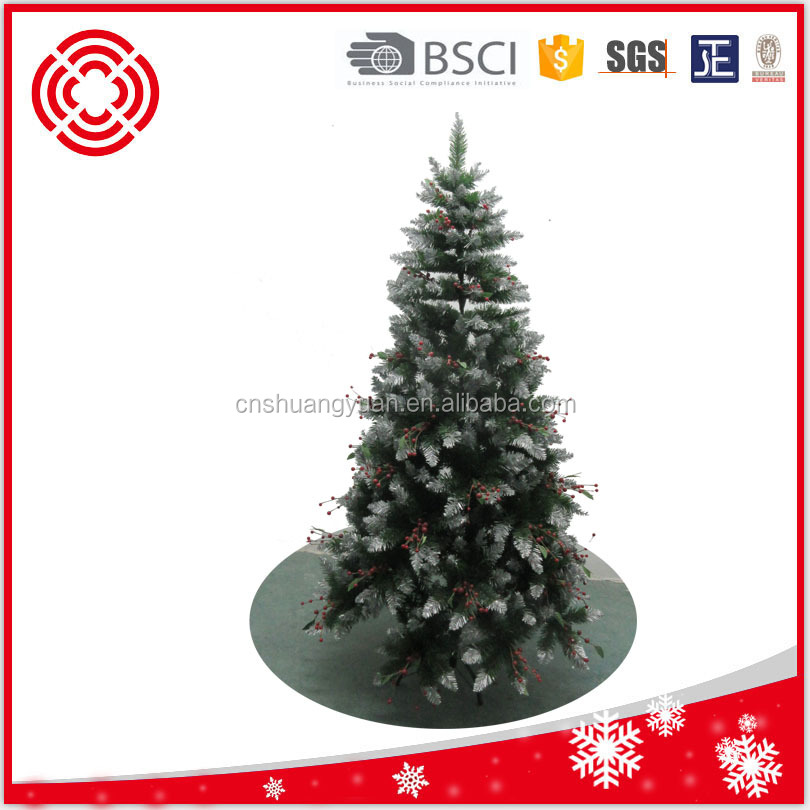 red berry decorated slim artificial christmas tree