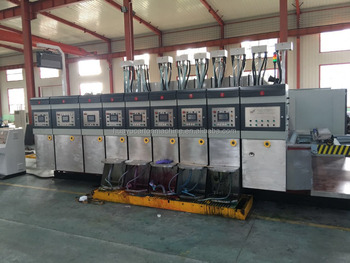 Fully computerized vacuum transfer flexo printer dryer slotter die cutter machine