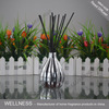 reed diffuser with sticks in sliver ceramic vase bottle
