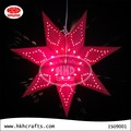 Red laser cut paper star light