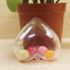 open xmas baubles, clear plastic xmas decoration in heart shape